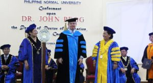 UNE-SiMERR Director receives honorary doctorate from PNU